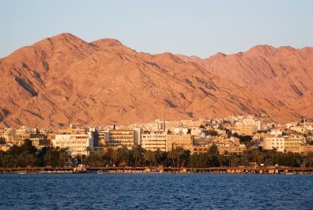 sunshine in aqaba city mountains