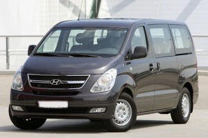 mini van black hyundai H1