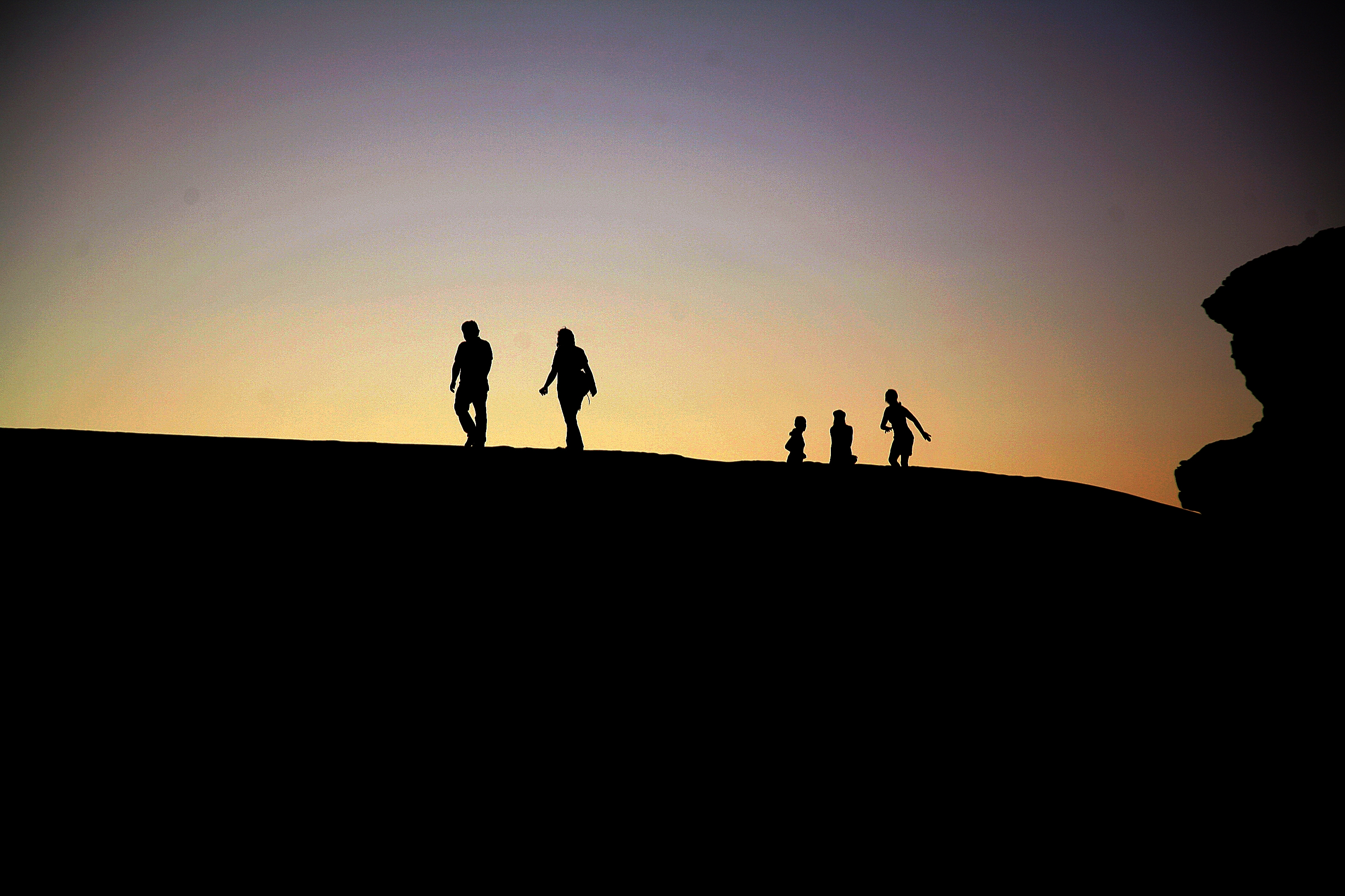 family at sunset in wadi rum jordan